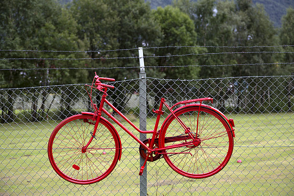 red bike on barbed wire