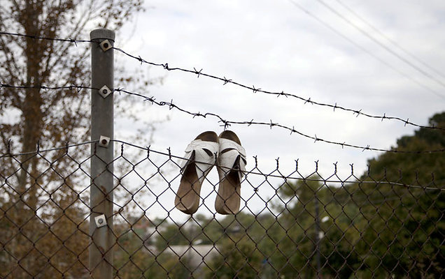 white pumps on fence